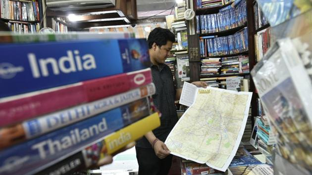 Abhinav Bamhi (above), of Faqir Chand & Sons bookstore in Khan Market, says the sale of travel guides is as steady as ever.(Raj K Raj/HT PHOTO)