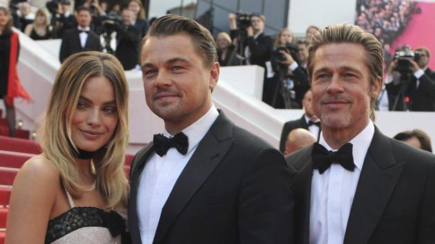 Actors Margot Robbie from left, Leonardo DiCaprio and Brad Pitt poses for photographers upon arrival at the premiere of the film Once Upon a Time in Hollywood at the 72nd international film festival, Cannes.(AP)