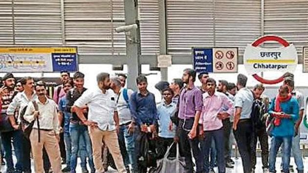 About 5,600 Metro commuters were stranded between Qutub Minar and Sultanpur after the overhead electrification wire broke down, halting operations for over four hours on Tuesday.(HTPhoto)