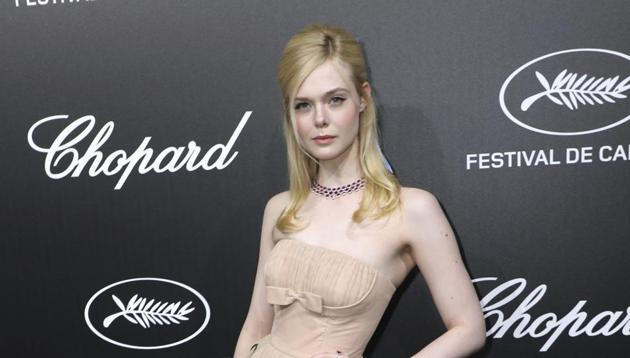 Elle Fanning poses for photographers upon arrival at the Chopard Trophee event.(Vianney Le Caer/Invision/AP)