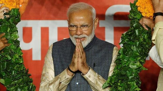 Prime Minister Narendra Modi gestures as he is presented with a garland by Bharatiya Janata Party (BJP) leaders after the election results in New Delhi, India, May 23, 2019.(REUTERS FILE PHOTO)