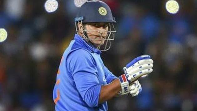 India's batsman MS Dhoni prepares to bat during the 3rd ODI cricket match against Australia.(AP)