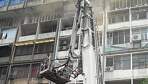 As many as 30 people were rescued by firefighters after a major fire broke out at Vishal Bhawan in Nehru Place on Thursday afternoon.(Sourced)