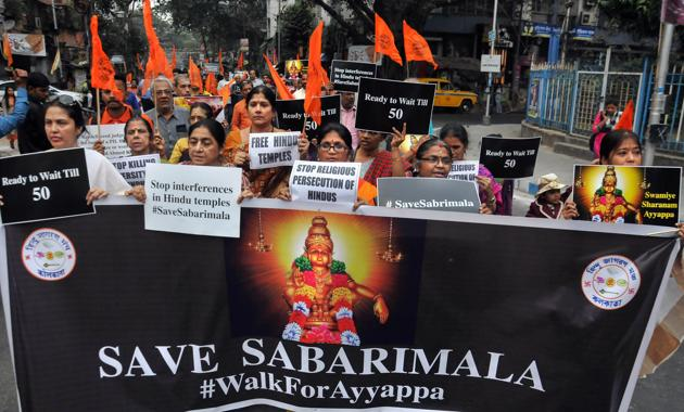 Devotees participate in a march 'Walk for Ayyappa' in relation to violence faced by devotees at Sabarimala's Ayyappa temple.(PTI photo)