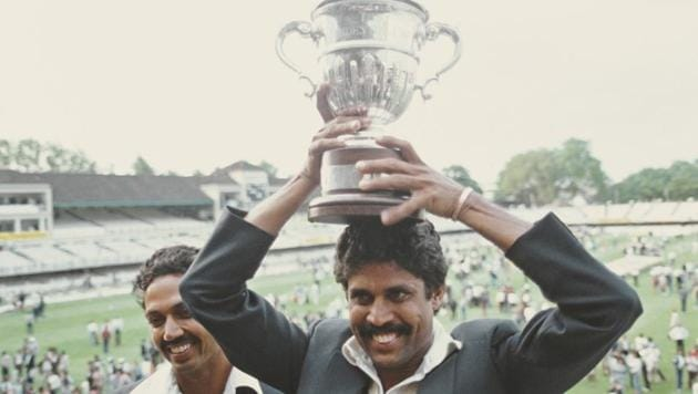 India players Kapil Dev (r) lifts the trophy as Man of the Match Mohinder Armanath looks on after the 1983 Prudential World Cup Final victory against West Indies at Lords on June 23, 1983 in London, England(Getty Images)