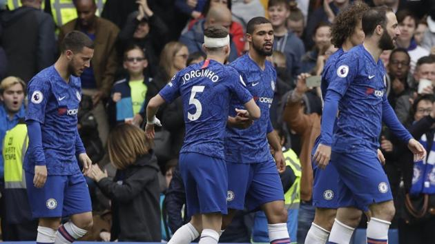 Chelsea's Ruben Loftus-Cheek, center, celebrates with teammates after scoring his side's first goal during the English Premier League soccer match between Chelsea and Watford at Stamford Bridge stadium in London, Sunday, May 5, 2019. (AP Photo/Matt Dunham)(AP)