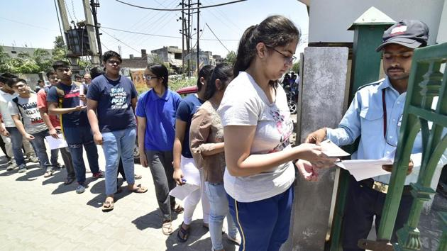 Students showing their ID cards before appearing in JEE Advances exam at ION digital zone center in Sherpur chowk in Ludhiana on Monday.(Gurpreet Singh/Hindustan Times)