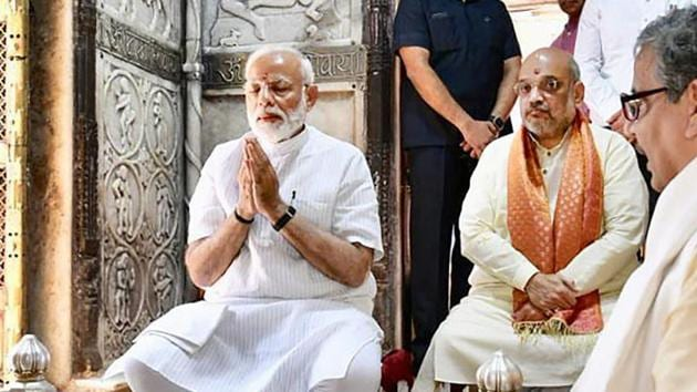 Prime Minister Narendra Modi along with BJP President Amit Shah offers prayers at Kashi Vishwanath Temple, during a visit to his parliamentary constituency Varanasi(PTI)