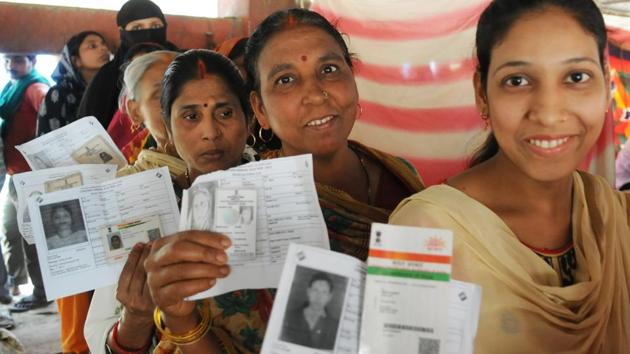 Women show their voter IDs as they stand in a queue during the seventh and last phase of Lok Sabha elections, at Naubatpur of Pataliputra constituency, in Patna, on Sunday, May 19, 2019.(AP Dube / HT Photo)