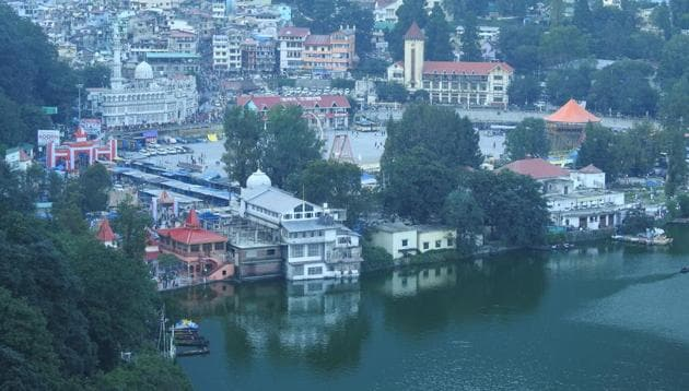 The Nainital lake is bound by the high and steep Naina peak on the north-west side, by the Tiffin Top to the south-west and snow view peaks on the north.(HT File)