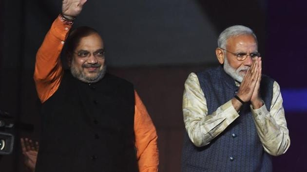 PM Narendra Modi (R) and Bharatiya Janta Party (BJP) president Amit Shah gesture to supporters as they celebrate the victory in India's general election at the party headquarters in New Delhi on May 23, 2019.(AFP file photo)