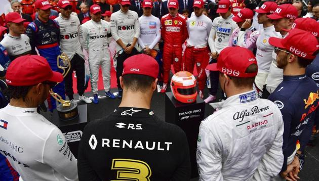 The drivers clap hands around a red helmet on a podest, reading 'Thank you Niki', during a minute of silence to tribute F1 legend Niki Lauda prior the Monaco Formula One Grand Prix race, at the Monaco racetrack(AP)