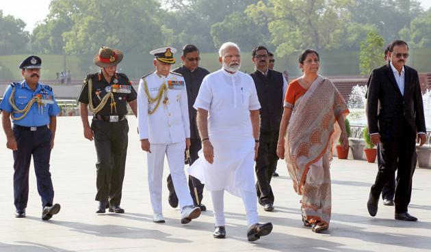 New Delhi: Prime Minister Narendra Modi along with Defence Minister Nirmala Sitharaman arrives to pay tribute at the War Memorial ahead of his swearing-in ceremony as the prime minister for the second consecutive term, in New Delhi, Thursday, May 30, 2019.(PTI)