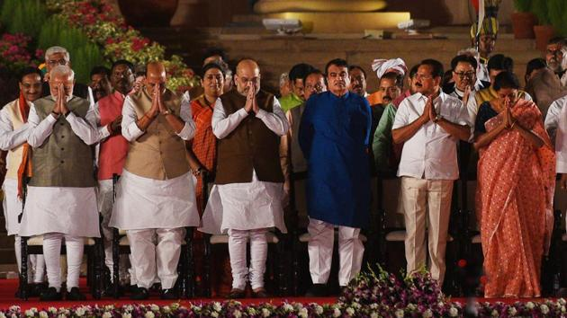 Prime Minister Narendra Modi and members of his cabinet stand for national anthem after taking oath during swearing-in ceremony, at Rashtrapati Bhavan, in New Delhi, India, on Thursday, May 30, 2019.(Ajay Aggarwal/HT PHOTO)