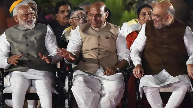 Prime Minister Narendra Modi with BJP leaders Rajnath Singh and Amit Shah before taking oath as the Prime Minister of India for the second consecutive term, at Rashtrapati Bhavan, in New Delhi, India, on Thursday, May 30, 2019.(Ajay Aggarwal/HT PHOTO)