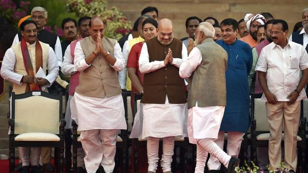 Prime Minister Narendra Modi greets Bharatiya Janata Party leaders Amit Shah, Rajnath Singh, Nitin Gadkari and others on their arrival for the swearing-in ceremony, at Rashtrapati Bhavan, in New Delhi, India, on Thursday, May 30, 2019. (Photo by Ajay Aggarwal/ Hindustan Times)