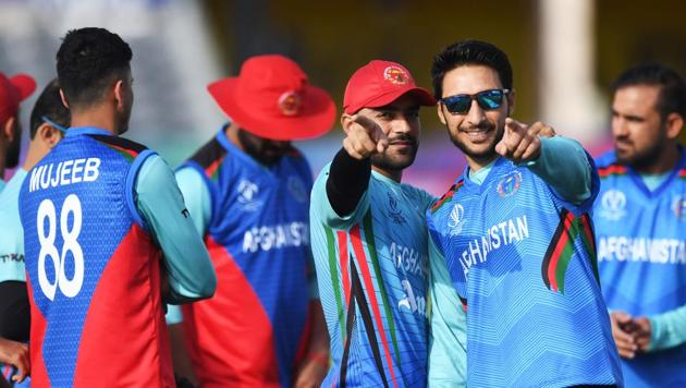 Afghanistan's Rashid Khan (C) and Afghanistan's Rahmat Shah take part in a training session(AFP)