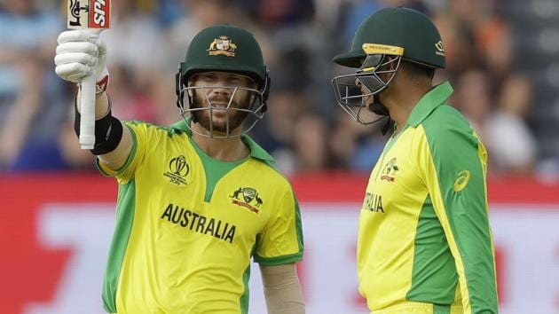 Australia's David Warner celebrates reaching 50 runs next to Australia's Usman Khawaja.(AP)