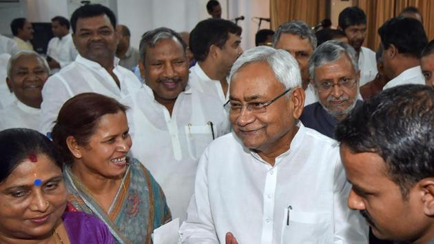 Bihar Chief Minister Nitish Kumar, along with deputy CM Sushil Kumar Modi, during the swearing-in ceremony for the cabinet expansion of coalition government of NDA, in Patna on June 2, 2019.(PTI)