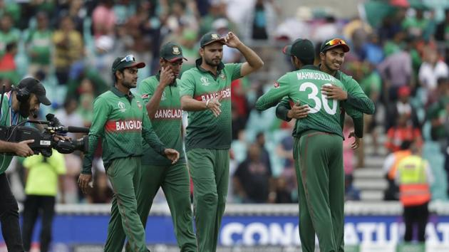 Bangladesh's captain Mashrafe Mortaza, centre, celebrates with his teammates as they walk off after winning by 21 runs in the Cricket World Cup match between South Africa and Bangladesh at the Oval in London, Sunday, June 2, 2019.(AP)