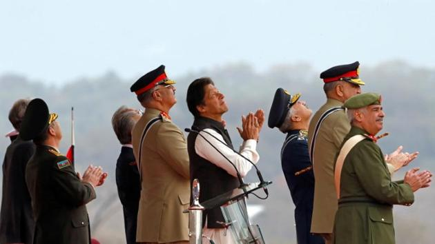 Pakistani Prime Minister Imran Khan applauses as he is observes the fly-past by Pakistan Air Force (PAF) JF-17 Thunder fighter jet during the Pakistan Day military parade in Islamabad, Pakistan March 23, 2019(REUTERS)