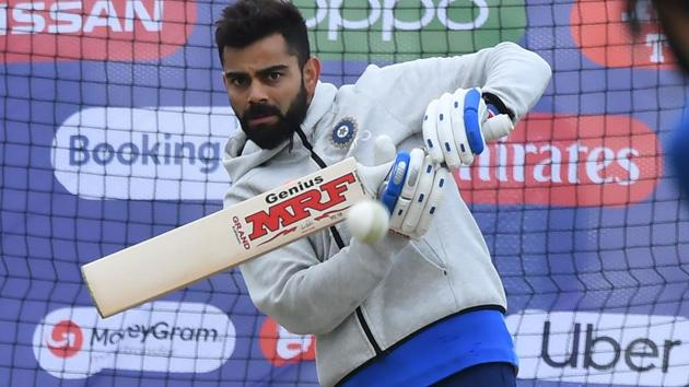 India's captain Virat Kohli bats in the nets during a training session at the Rose Bowl in Southampton.(AFP)
