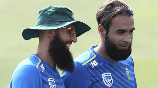 South Africa's Hashim Amla, left, and Imran Tahir attend a training session.(AP)