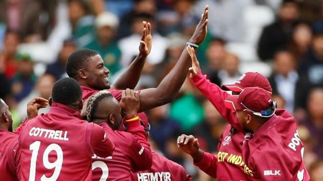 ICC Cricket World Cup - West Indies v Pakistan - Trent Bridge, Nottingham, Britain - May 31, 2019 West Indies' Jason Holder celebrates with team mates after taking the wicket of Pakistan's Sarfaraz Ahmed Action Images via Reuters/Jason Cairnduff/File Photo(Action Images via Reuters)