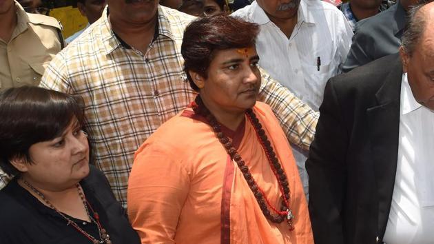 Sadhvi Pragya Thakur (C) arrives to appear in the special court in Mumbai on June 7, 2019.(AFP)