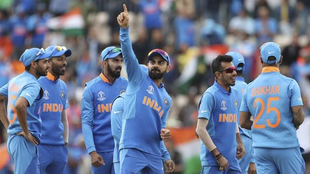 India's captain Virat Kohli, center, dances to celebrate the dismissal of South Africa's Quinton de Kock.(AP)