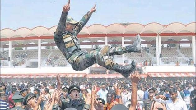 Gentleman Cadets celebrate their commissioning in the Indian Army at IMA in Dehradun on Saturday.(HT Photo)