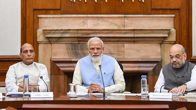 New Delhi: Prime Minister Narendra Modi with Union Ministers Nitin Gadkari, Rajnath Singh, Amit Shah and others during the first cabinet meeting(PTI)