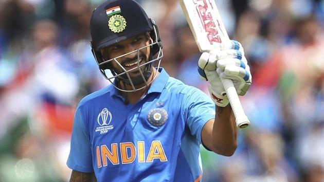 India's Shikhar Dhawan raises his bat to celebrate against Australia.(AP)