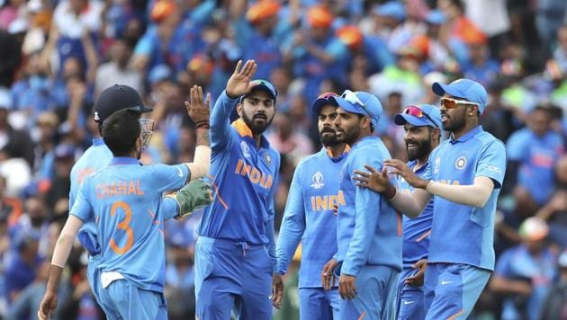 Indian players celebrate the dismissal of Australia's Glenn Maxwell during the Cricket World Cup match between Australia and India at The Oval in London, Sunday, June 9, 2019(AP)