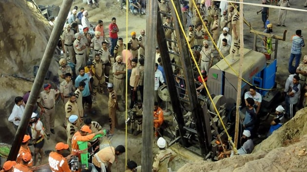 A two-year-old child, who had fallen into a 150-foot-deep unused borewell while playing, was pulled out of it this morning in a frantic rescue operation after almost 110 hours.(Bharat Bhushan / Hindustan Times)