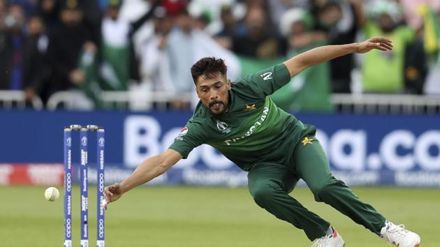 Pakistan's Mohammad Amir dives to field the ball during the Cricket World Cup match between England and Pakistan at Trent Bridge in Nottingham, Monday, June 3, 2019. (AP Photo/Rui Vieira)(AP)