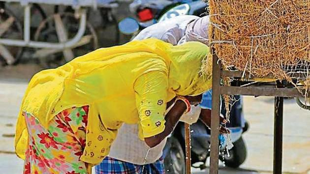 An elderly woman drinks water on a hot summer day in Churu, Rajasthan. Churu recorded 50.8 degrees Celsius on June 1.(PTI File Photo)