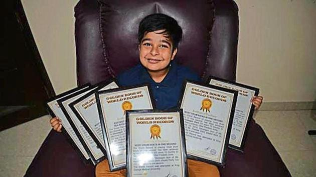 Devaagyh Dixit with his certificates of records.(HT photo)
