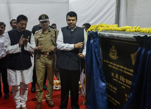 CM Devendra Fadnavis (right) with police chief Sanjay Barve (centre) and MoS for home Deepak Kesarkar at the foundation stone laying event of the cybercrime police station in Bandra.(Kunal Patil/HT Photo)