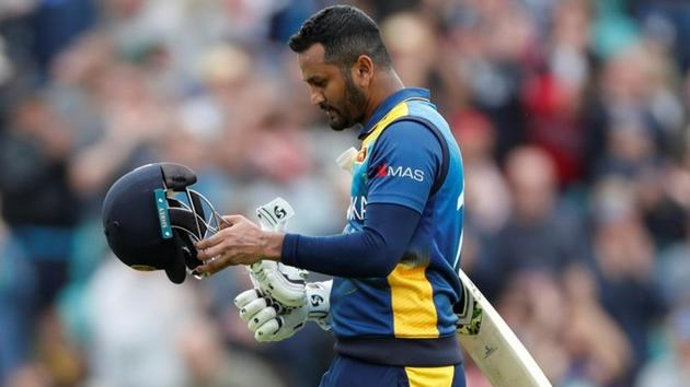 Sri Lanka's Dimuth Karunaratne looks dejected as he walks off the pitch after being caught out by Glenn Maxwell.(Action Images via Reuters)