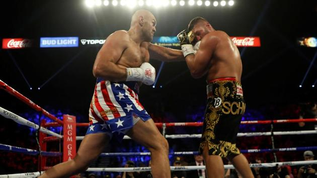 Tyson Fury and Tom Schwarz in action.(REUTERS)