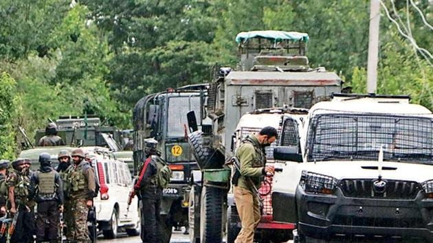 Army personnel cordon off the area in Pulwama where an IED blast took place on Monday evening. (ANI photo)