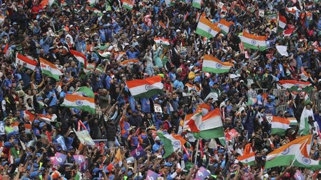 Manchester: Indian fans celebrate a boundary hit by India's Rohit Sharma during the Cricket World Cup match between India and Pakistan at Old Trafford in Manchester, England, Sunday, June 16, 2019(AP)