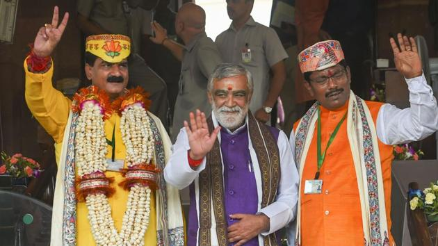 BJP MP's Gopal Jee Thakur and Ashok Kumar Yadav with Minister of State in the Ministry of Health and Family Welfare Ashwini Kumar Choubey arrive for the first session of the 17th Lok Sabha at Parliament House in New Delhi.(PTI Photo)