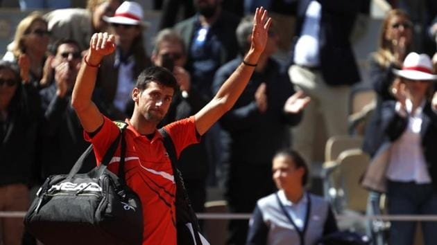 Serbia's Novak Djokovic greets the crowd as he leaves the court.(REUTERS)