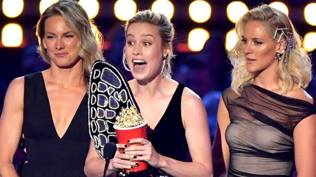 Brie Larson and stunt doubles (L-R) Ingrid Kleinig and Joanna Bennett accept the Best Fight award for Captain Marvel onstage during the 2019 MTV Movie and TV Awards.(AFP)