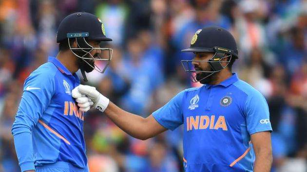 India's Rohit Sharma (R) congratulates India's K.L. Rahul after scoring a half-century (50 runs) during the 2019 Cricket World Cup group stage match between India and Pakistan.(AFP)