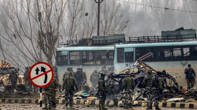 Security personnel carry during rescue and relief works at the site of suicide bomb attack at Lathepora Awantipora in Pulwama district of south Kashmir, Thursday, February 14, 2019.(PTI Photo)