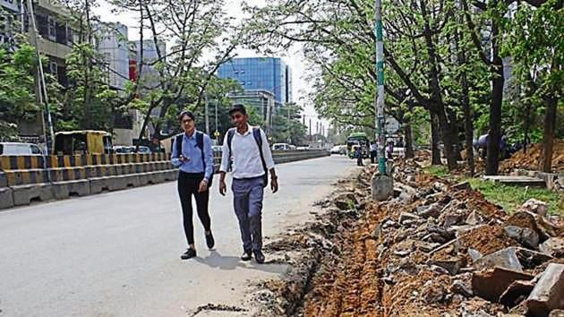 Even five months after the groundbreaking ceremony for widening and re-carpeting three roads in Udyog Vihar was done, there has hardly been any progress in the work on the ground, said factory owners on Wednesday.(Yogendra Kumar/HT PHOTOs)