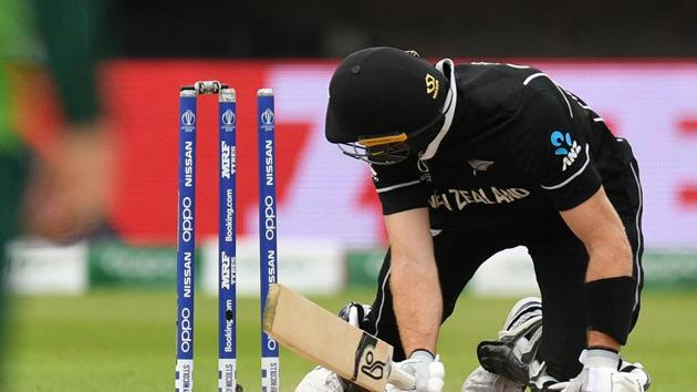 New Zealand's Martin Guptill looks at the stumps after kncoking the bails off and losing his own wicket for 35 runs during the 2019 Cricket World Cup group stage match between New Zealand and South Africa at Edgbaston in Birmingham(AFP)